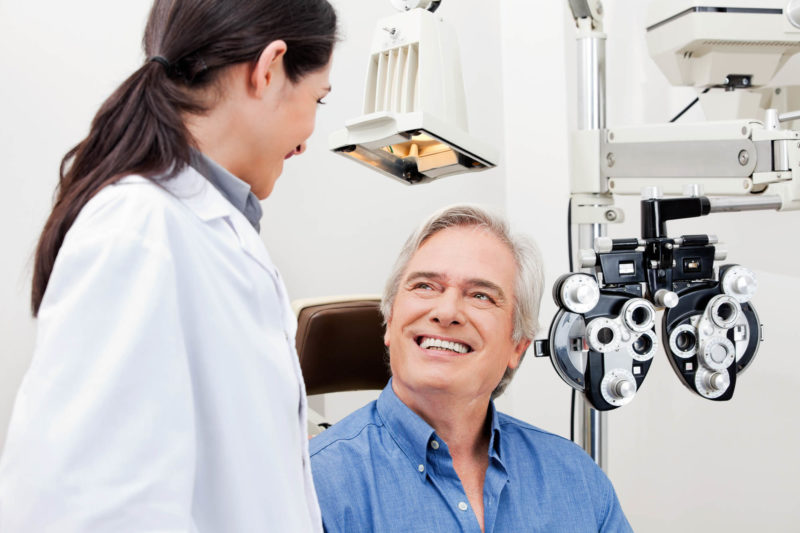 A man smiles at his eye doctor